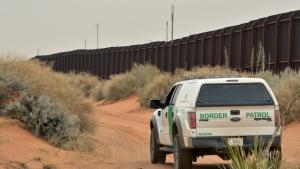 A U.S. Border Patrol agent drives near the U.S.-Mexico border fence in Santa Teresa, N.M. on Jan. 4, 2016. (Russell Contreras/AP)