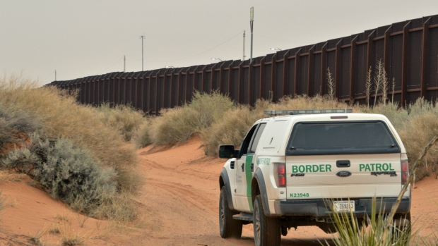 A U.S. Border Patrol agent drives near the U.S.-Mexico border fence in Santa Teresa, N.M. on Jan. 4, 2016. (Russell Contreras/AP)