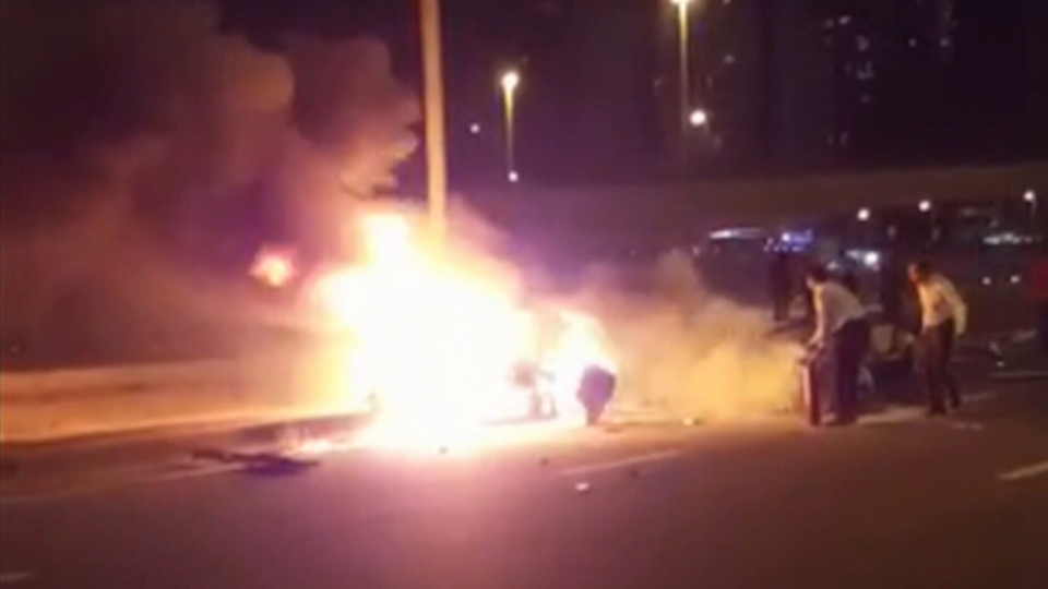 A photo taken from video shows appears to show a fiery car crash in Dubai, on Sunday, March 6, 2016.