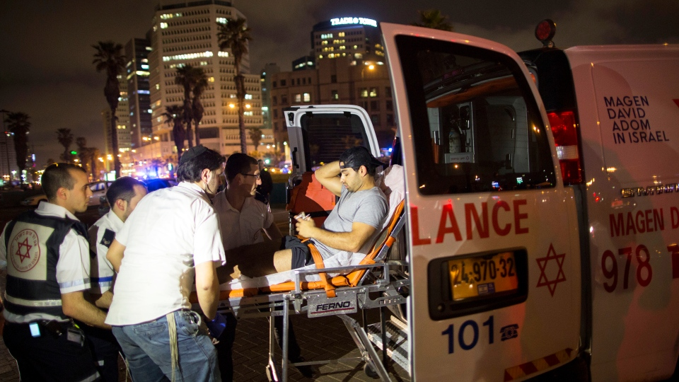 A wounded man is evacuated from the scene of a stabbing attack in Jaffa, a mixed Jewish-Arab part of Tel Aviv, Israel, Tuesday, March 8, 2016. (AP / Oded Balilty)