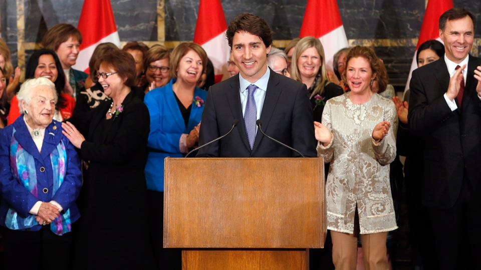 Prime Minister Justin Trudeau takes part in celebrating International Women's Day with his wife Sophie Gregoire-Trudeau and Finance Minister Bill Morneau (far right) along with women from his caucus as he acknowledges former Mississauga mayor Hazel McCallion (far left) on Parliament Hill in Ottawa, Tuesday, March 8, 2016. (Fred Chartrand / THE CANADIAN PRESS)