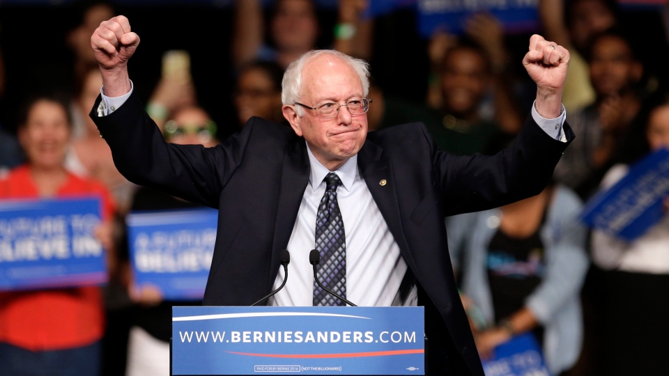 Democratic presidential candidate, Sen. Bernie Sanders, acknowledges his supporters on arrival at a campaign rally, in Miami, Fla., on Tuesday, March 8, 2016. (AP Photo/Alan Diaz)