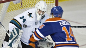 San Jose Sharks goalie James Reimer makes the save on Edmonton Oilers' Jordan Eberle during first period NHL action in Edmonton, Alta., on Tuesday, March 8, 2016. (Jason Franson / THE CANADIAN PRESS)