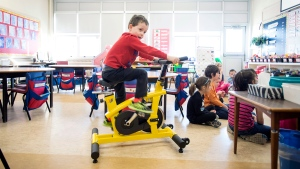 Andrew Tilley, 5, rides a stationary bike during a lesson in teacher Mary Theresa Burt's classroom at Ian Forsyth Elementary School in Dartmouth, N.S. on Monday, March 7, 2016. (Darren Calabrese/THE CANADIAN PRESS)