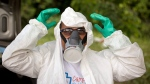 A municipal health worker prepares to apply insecticide in a junk yard to combat the Aedes aegypti mosquito that transmits the Zika virus in Joao Pessoa, Brazil, Monday, Feb. 22, 2016. (AP/Andre Penner)