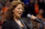 Canadian singer Sarah McLachlan sings the national anthem at B.C. Place stadium in Vancouver, B.C., on Sept. 30, 2011. (The Canadian Press/Darryl Dyck)