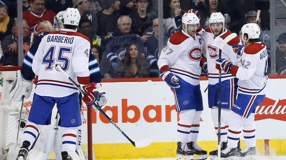 Montreal Canadiens' Max Pacioretty (67), Alex Galchenyuk (27) and Sven Andrighetto (42) celebrate Galchenyuk's goal against the Winnipeg Jets during second period NHL action in Winnipeg on Saturday, March 5, 2016. THE CANADIAN PRESS/John Woods