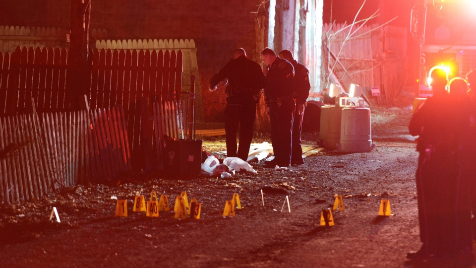 Police investigate the scene after a deadly shooting in Wilkinsburg, Pa. on Wednesday, March 9, 2016. (Michael Henninger / Pittsburgh Post-Gazette)