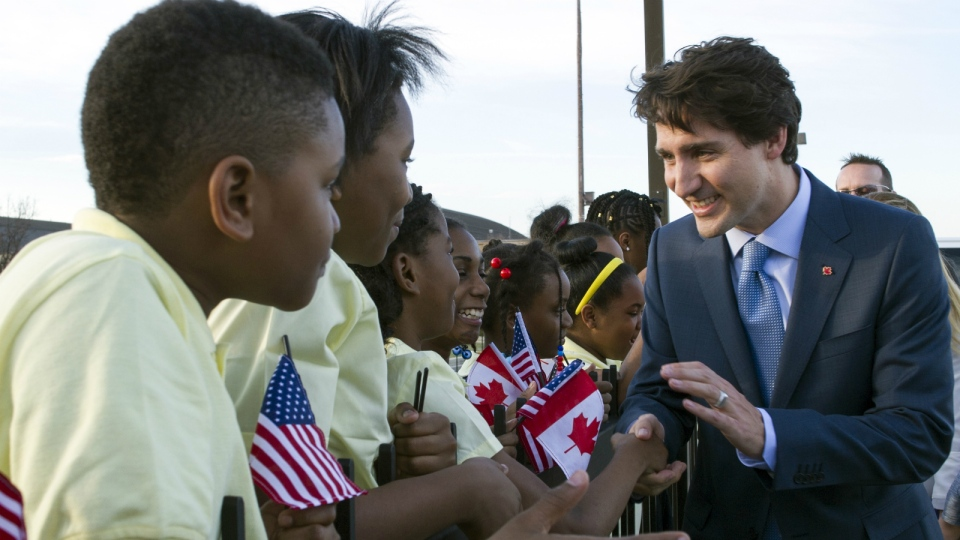Canadian Prime Minister Justin Trudeau greets students from D.C.'s Patterson Elementary School after he arrived at Andrews Air Force Base, Md. on Wednesday, March 9, 2016. (AP / Cliff Owen)