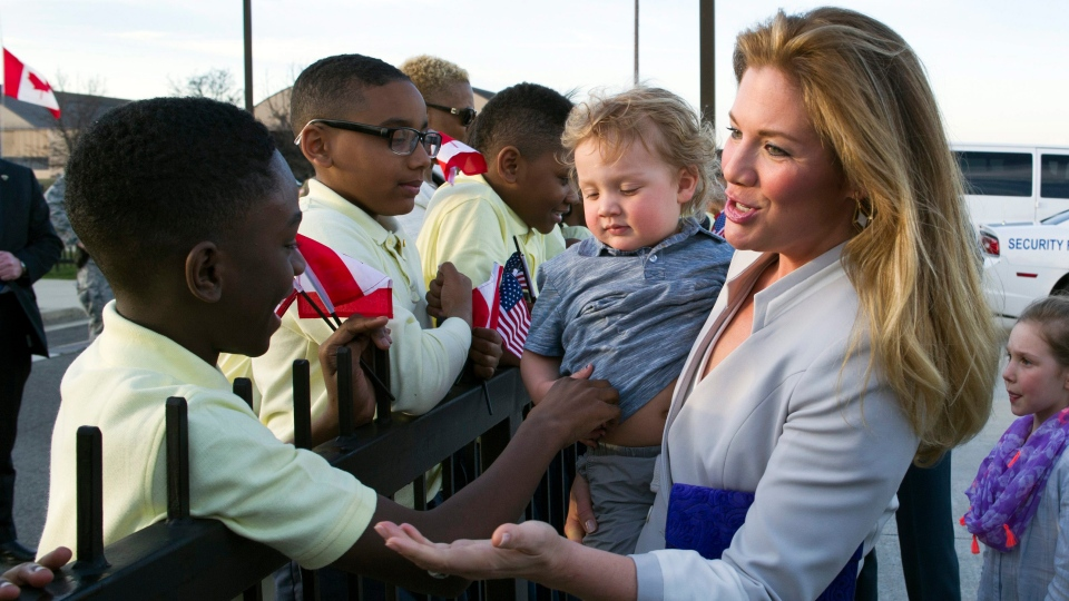 Sophie Gregoire Trudeau, wife of Canadian Prime Minister Justin Trudeau, holds their son Hadrien Gregoire while she greets students from D.C.'s Patterson Elementary School, after arriving at Andrews Air Force Base, Md., Wednesday, March 9, 2016. (AP / Cliff Owen)