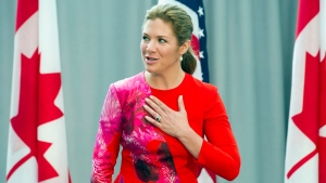 Sophie Grégoire-Trudeau, wife of Canadian Prime Minister Justin Trudeau, places her hand over her heart while participating in a program at the U.S. Institute of Peace in Washington, Thursday, March 10, 2016, to highlight Let Girls Learn efforts and raise awareness for global girl's education. (AP Photo/Cliff Owen)
