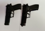 Woodstock police photo of a real handgun (left) beside BB gun. (Courtesy: Woodstock police)