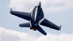 A Boeing F/A-18 E/F Super Hornet flies on display during Farnborough International Air Show, in Farnborough, England, on Tuesday, July 15, 2014. (AP Photo/Sang Tan)