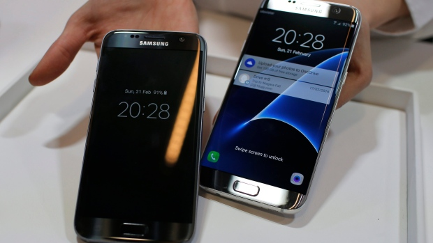 A Samsung Galaxy S7, left, and S7 Edge are displayed during the Samsung Galaxy Unpacked 2016 event on the eve of the Mobile World Congress wireless show, in Barcelona, Spain, on Sunday, Feb. 21, 2016. (AP / Manu Fernadez)