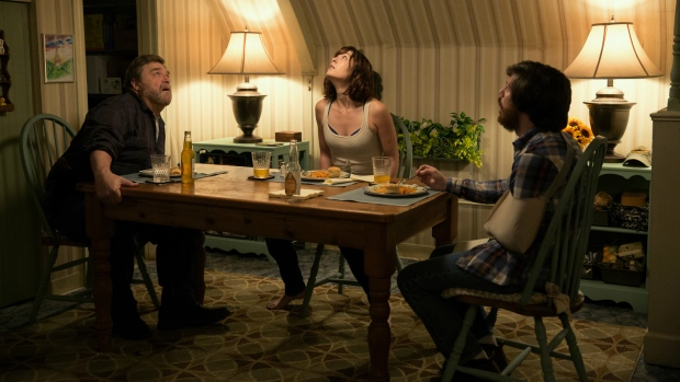 John Goodman, from left, Mary Elizabeth Winstead and John Gallagher Jr. are seen in a scene from '10 Cloverfield Lane.' (Michele K. Short / Paramount Pictures)