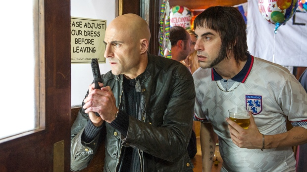 Mark Strong, left, and Sacha Baron Cohen are seen in Columbia Pictures' 'The Brothers Grimsby.' (Daniel Smith / Sony Pictures)