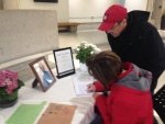 Members of the public sign a book of condolences at Barrie City Hall in Barrie, Ont. on Friday, March 11, 2016. (Geoff Bruce/ CTV Barrie)