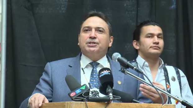 Perry Bellegarde, National Chief of the Assembly of First Nations, addresses a rally at Portage Place Shopping Centre on Friday as Wab Kinew, NDP candidate in Fort Rouge, looks on.