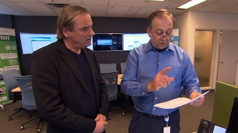 W5's Victor Malarek (left) standing with Aviva fraud investigator Doug Dunstan (W5).
