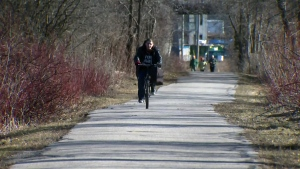 A man rides his bicycle along the Iron Horse Trail in Kitchener on Friday, March 11, 2016.