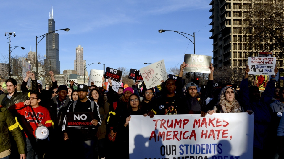 Protesters march against Trump, in Chicago, on Friday, March 11, 2016. (AP Photo/Matt Marton)
