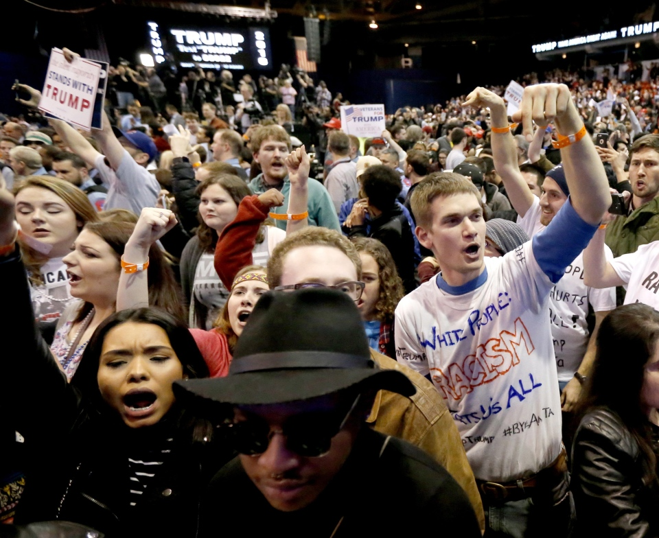 Protesters of Republican presidential candidate Donald Trump, right, chant after a rally on the campus of the University of Illinois-Chicago, was canceled due to security concerns Friday, March 11, 2016, in Chicago. (AP/Charles Rex Arbogast)