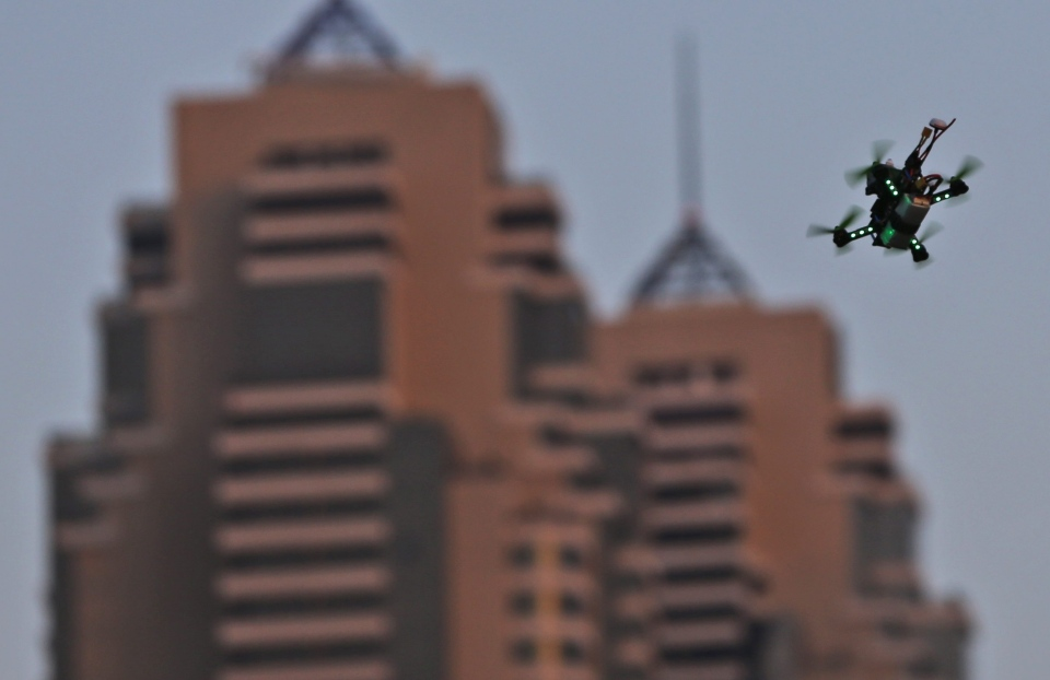 A drone flies during the final day of the first World Drone Prix in Dubai, United Arab Emirates, Saturday, March 12, 2016. (AP/Kamran Jebreili)