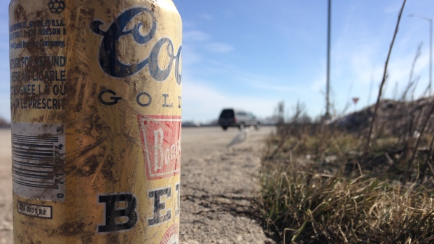 A beer can tossed on the side of the highway can be seen in Innisfil, Ont. on Saturday, March 12, 2016. (K.C. Colby/ CTV Barrie)