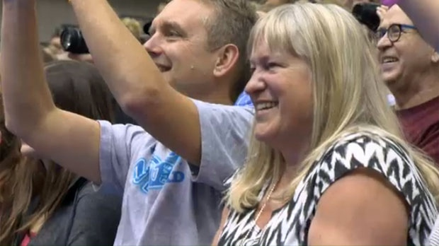 Family of Natasha Gould cheer during the Calgary Stars cheer performance
