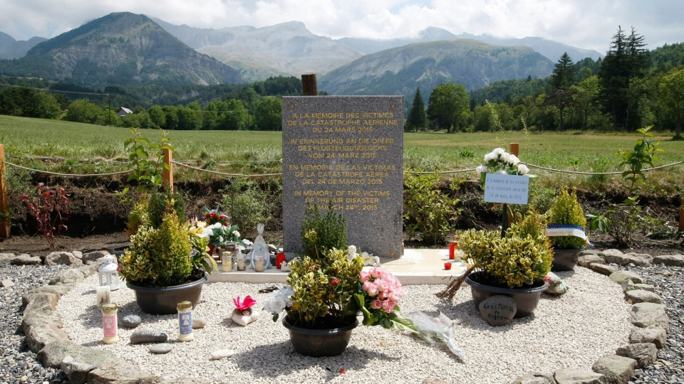 In this July 24, 2015 file picture a stele, a stone slab erected as a monument, set up in the area near where a Germanwings aircraft crashed in the French Alps, in Le Vernet, French Alps. (AP / Claude Paris,file)