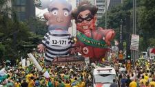 Brazil demonstrators parade large inflatable dolls