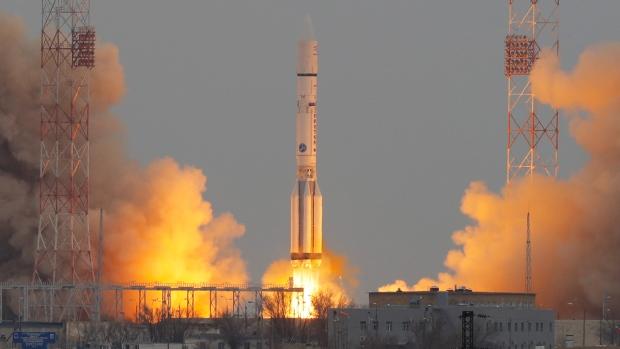 Proton-M rocket booster blasts off