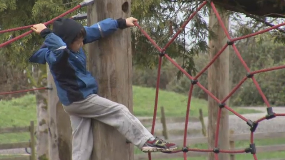 Lochlan Higgs is seen climbing at the Terra Nova Adventure playground in Richmond, B.C.