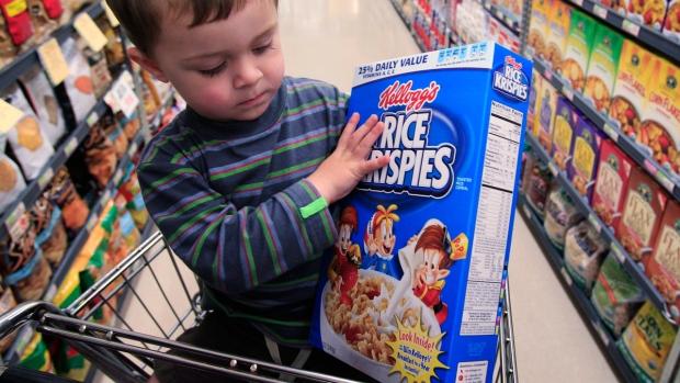 Examining a Kellogg's Rice Krispies cereal box