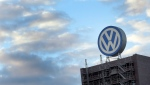 A giant logo of the German car manufacturer Volkswagen is pictured on top of a company's factory building in Wolfsburg, Germany on Sept. 26, 2015 . (AP / Michael Sohn)