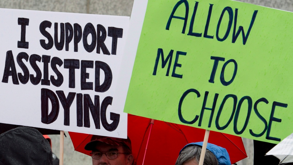 Supporters rally outside the Supreme Court of Canada on the first day of hearings into assisted dying, in Ottawa, on Wed., Oct. 15, 2014. (Adrian Wyld / THE CANADIAN PRESS)
