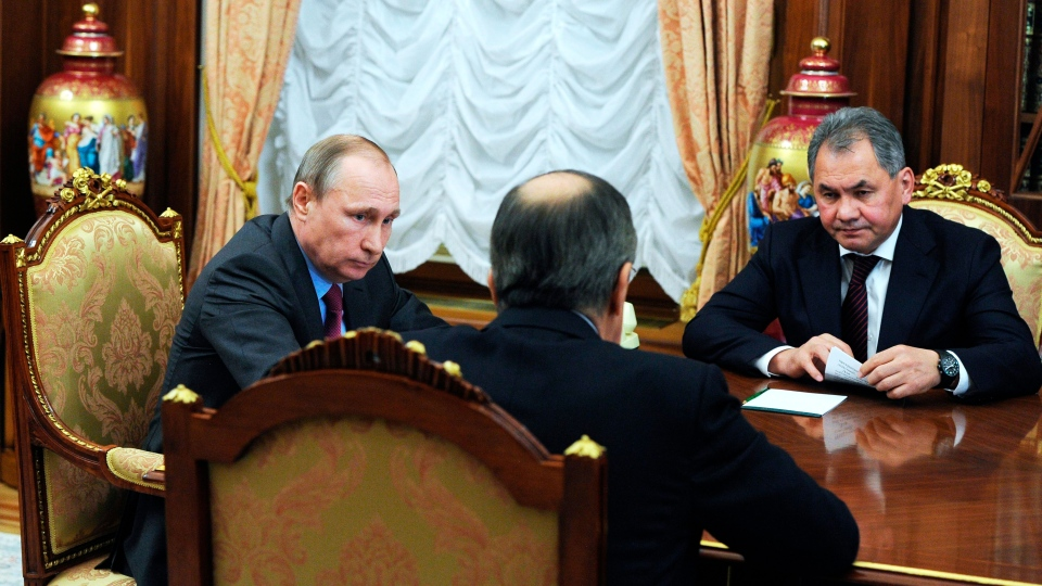 Russian President Vladimir Putin, left, Russian Foreign Minister Sergey Lavrov, back to a camera, and Russian Defense Minister Sergey Shoygu, right, speak during their meeting in the Kremlin in Moscow, Russia, Monday, March 14, 2016 (Kremlin Pool Photo via AP / Mikhail KlimentyevSputnik)