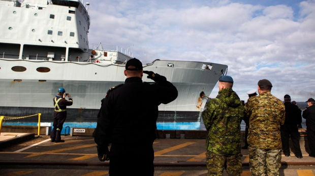 In this file photo, Royal Canadian Navy personnel salute HMCS Protecteur as it leaves CFB Esquimalt in Esquimalt, B.C., Wednesday, February 24, 2016. (Chad Hipolito/THE CANADIAN PRESS)