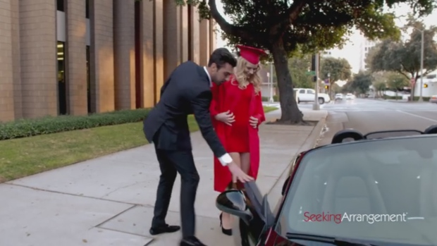 A woman is shown getting into a man's car in this still image from a 'Sugar Baby University' advertisement. (SeekingArrangement / YouTube)