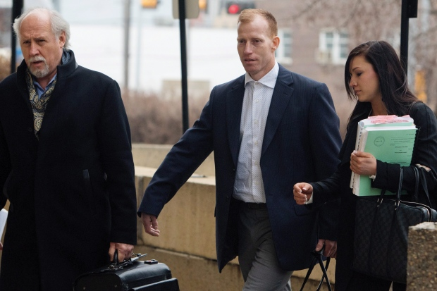 Travis Vader, centre, arrives at court with lawyer Brian Beresh, left, in Edmonton on Tuesday, March 8, 2016. (Amber Bracken / THE CANADIAN PRESS)