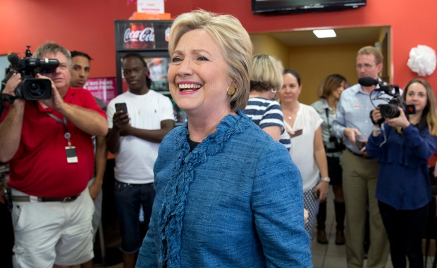 Democratic presidential candidate Hillary Clinton smiles as she visits a Dunkin' Donuts in West Palm Beach, Fla., Tuesday, March 15, 2016. (AP / Carolyn Kaster)