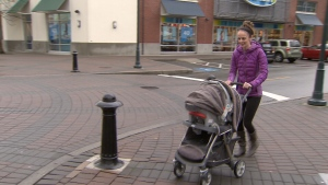 Mom pushing stroller in West Vancouver