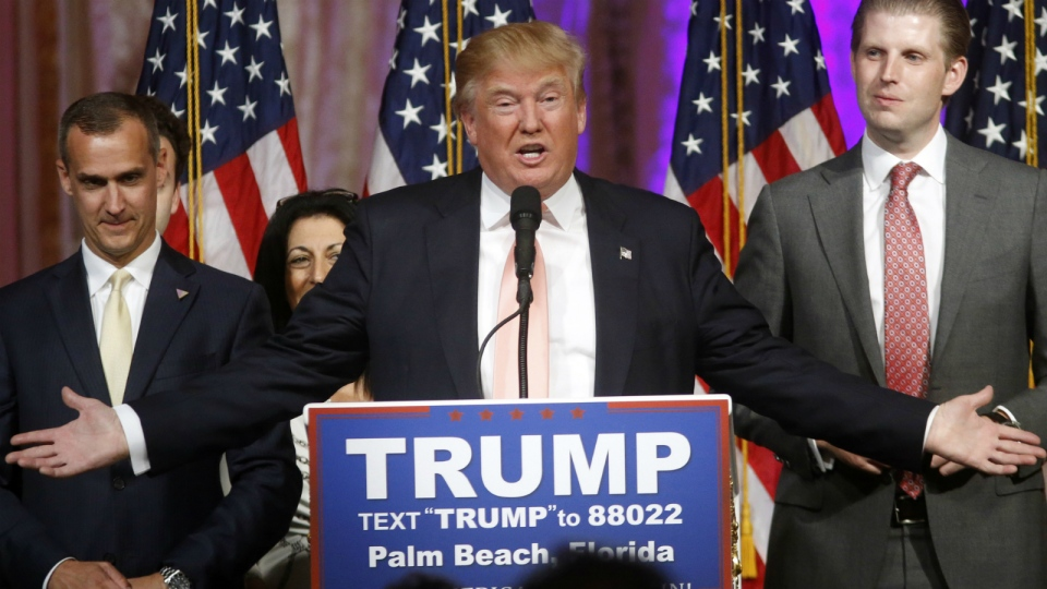Republican presidential candidate Donald Trump speaks to supporters at his primary election night, with his son Eric Trump to the right and his campaign manager Corey Lewandowski to the left, at an event at his Mar-a-Lago Club in Palm Beach, Fla. on Tuesday, March 15, 2016. (AP / Gerald Herbert)