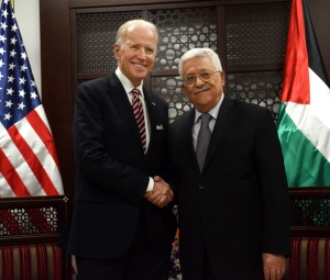 U.S. Vice President Joe Biden, left, and Palestinian President Mahmoud Abbas, shake hands for the press at the presidential compound in Ramallah, West Bank, Wednesday, March 9, 2016. (Debbie Hill, Pool via AP)