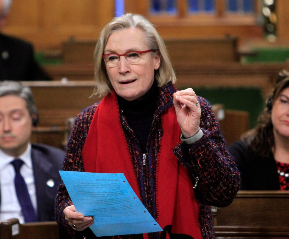 Carolyn Bennett, Minister of Indigenous and Northern Affairs stands in the House of Commons during question period on Parliament Hill in Ottawa on Friday, March 11, 2016. (Fred Chartrand /THE CANADIAN PRESS)