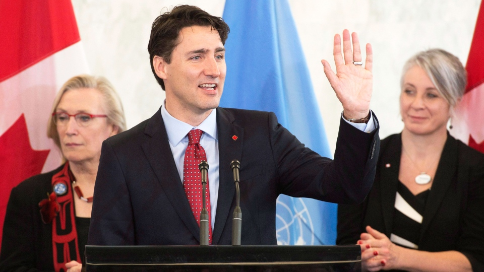 Canadian Prime Minister Justin Trudeau waves as he wraps up his remarks during an event at the United Nations headquarters in New York, Wednesday March 16, 2016. (Adrian Wyld / THE CANADIAN PRESS)