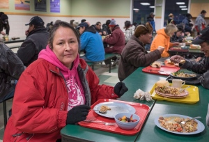 Hazel Cripps, an Ojibway from Eagle Lake First Nation in Ontario, has dinner at the Shelter House in Thunder Bay, Ont. on Thursday, March 3, 2016. (Paul Chiasson / THE CANADIAN PRESS)