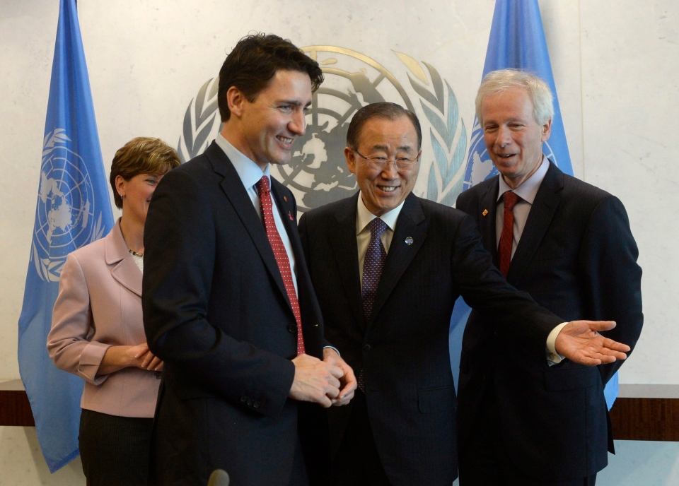 Prime Minister Justin Trudeau (left) is welcomed by United Nations General Secretary Ban Ki-moon as Foreign Affairs Minister Stephane Dion looks on at the United Nations headquarters in New York, Wednesday March 16, 2016. (Adrian Wyld / THE CANADIAN PRESS)