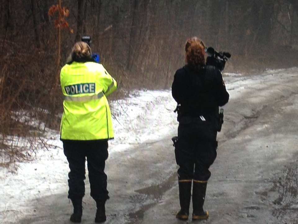 OPP officers investigate an area of the Simcoe County forest, following the discovery of human remains near Midhurst, Ont. on Wednesday, March 16, 2016. (Brandon Rowe/ CTV Barrie)