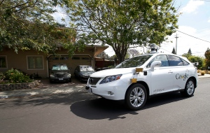 In this Wednesday, May 13, 2015, file photo, Google's self-driving Lexus car drives along street during a demonstration at Google campus on in Mountain View, Calif. (Tony Avelar / AP Photo)